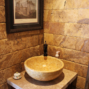 bathroom stone wall and sink | toscano tile and marble